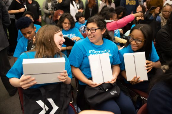 Comcast Digital Inclusion Rally Pennsylvania School for the Deaf 3 female students hold ipads donated by Comcast and Dell