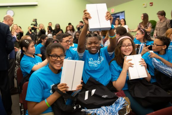 Comcast Digital Inclusion Rally Pennsylvania School for the Deaf excited female deaf students show off their ipads from Comcast