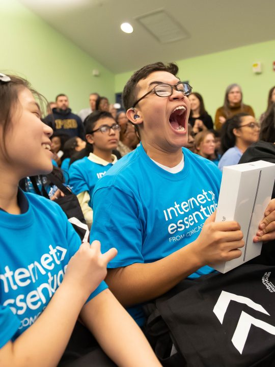 Comcast Digital Inclusion Rally Pennsylvania School for the Deaf very happy deaf boy holds ipad donated from Comcast