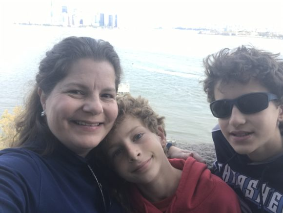 mom selfie with boys at the Statue of Liberty pedestal