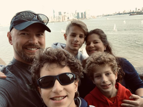 family selfie at the Statue of Liberty pedestal