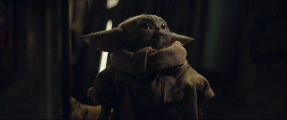 Baby yoda looking sad.