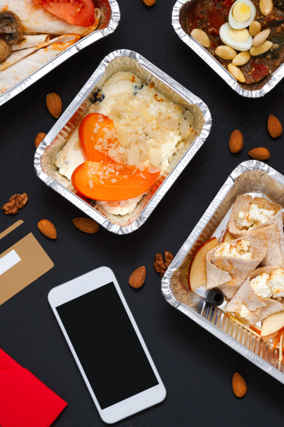 cell phone with take out food containers filled with food