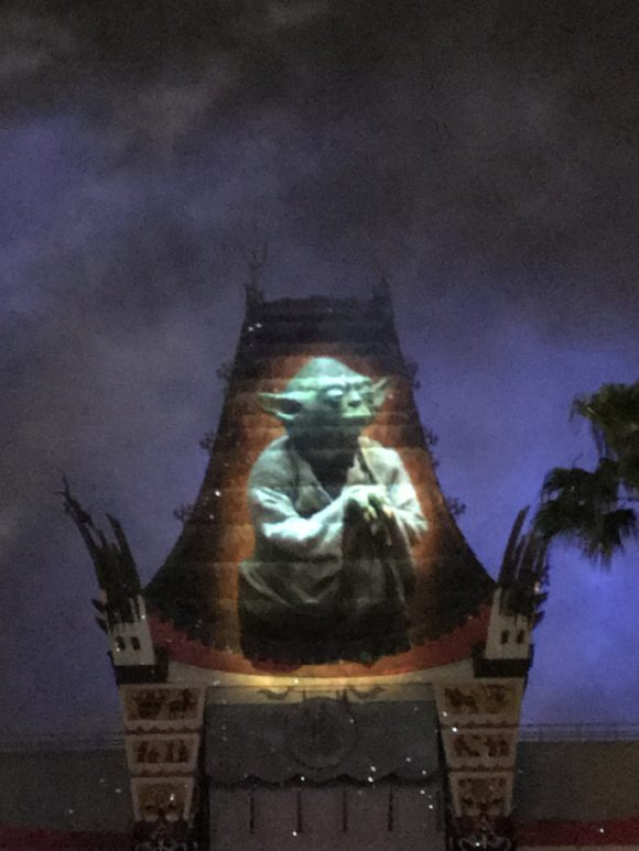 Yoda is projected onto a building as part of the Star Wars Galactic Spectacular at Walt Disney World Hollywood Studios.