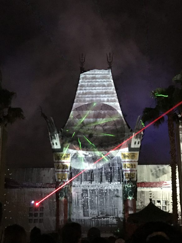 lasers shoot across the Millennium Falcon image as part of Star Wars Galactic Spectacular at Walt Disney World Hollywood Studios.