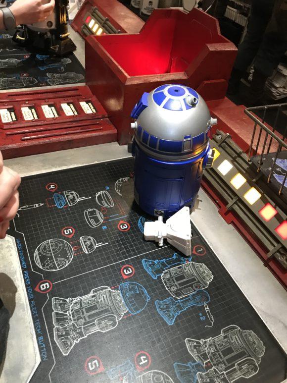 Assembling a droid at the at Star Wars Galaxy's Edge at Walt Disney World Hollywood Studios