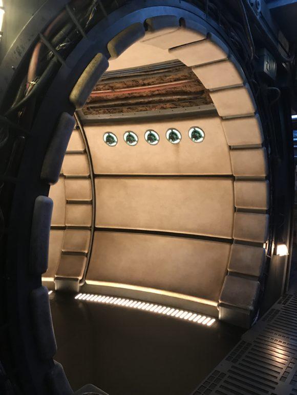 Inside the queue of the Smugglers Run Millennium Falcon at Star Wars Galaxy's Edge at Walt Disney World.