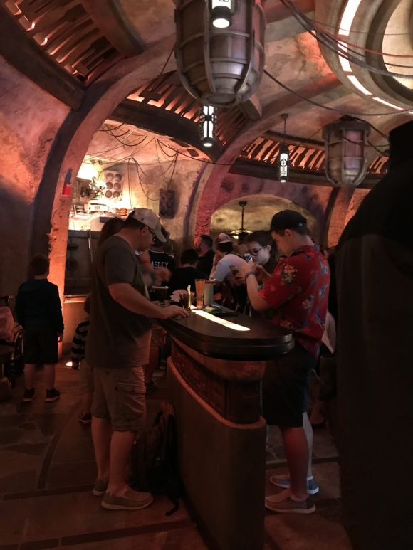 Table tops with people at Star Wars Galaxy's Edge Oga's Cantina