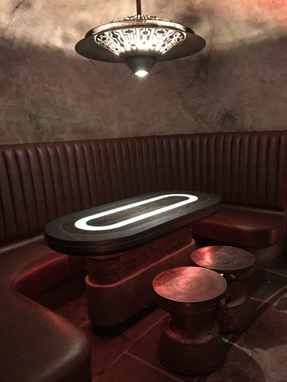 A booth for seating at Oga's Cantina at Star Wars Galaxy's Edge.