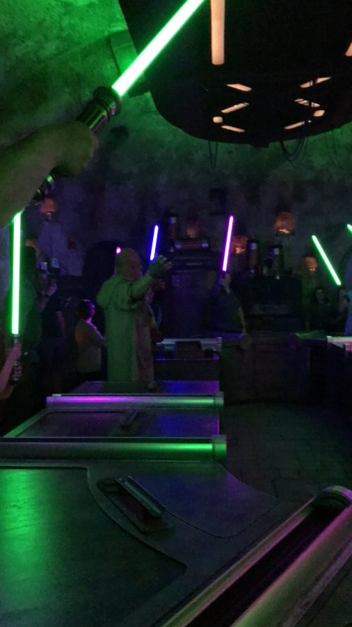 The lighting up of lightsabers at Savi's Workshop at Star Wars Galaxy's Edge.