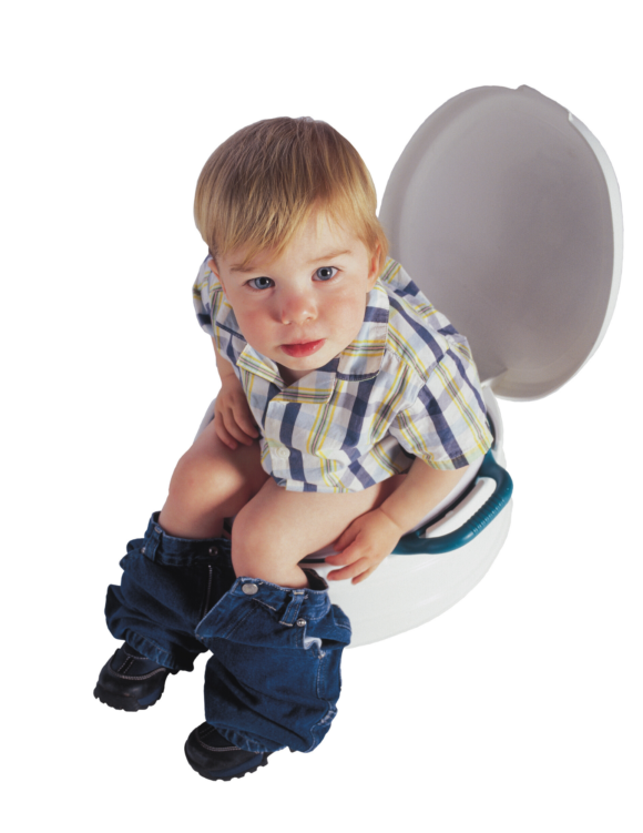 toddler sits on portable potty