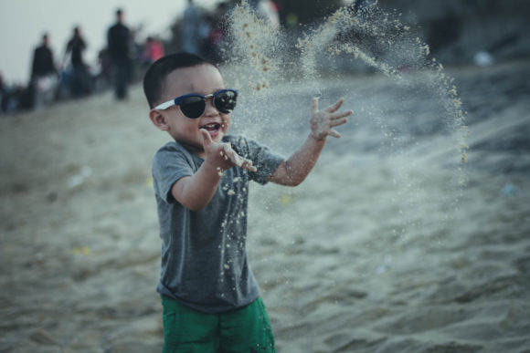Canva-Boy-Throwing-Sands