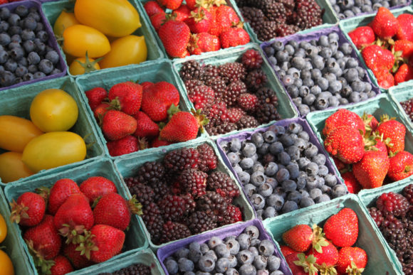 Berries and fruits in small crates