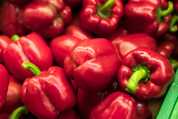 Fresh red organic sweet bell peppers on the farmer market on a tropical island Bali.