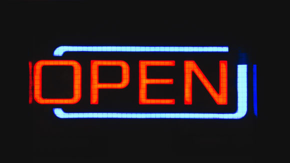 A neon open sign shows a location open in New Jersey