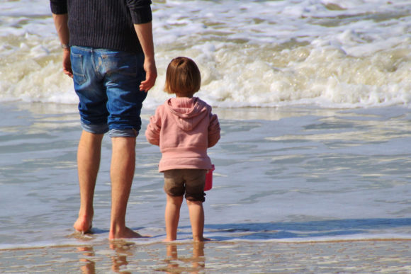 social distancing at the Jersey Shore beaches a father and child wade in the water