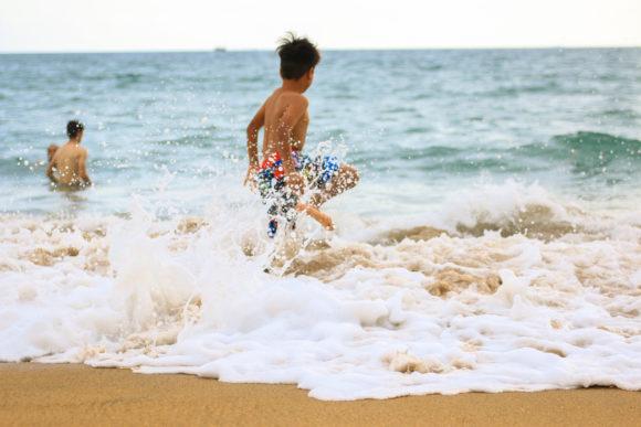 Canva-Photo-of-Boy-Rushing-Towards-Sea