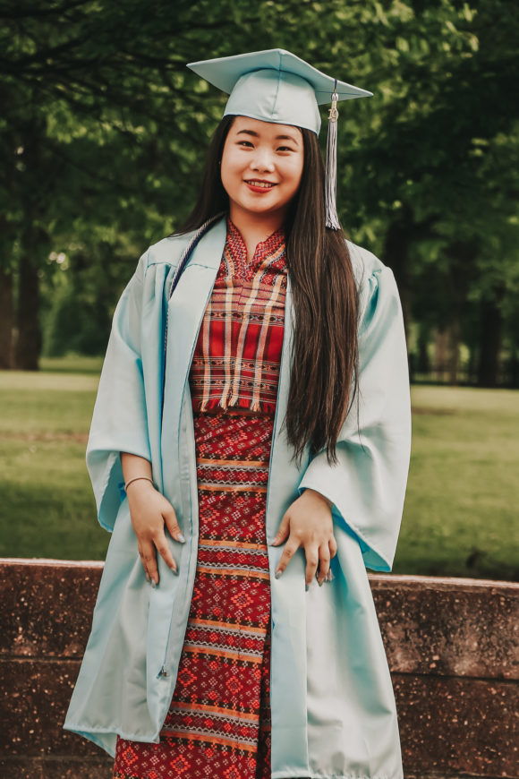 Canva - Photo of Standing Woman in Blue Academic Regalia Smiling.jpg