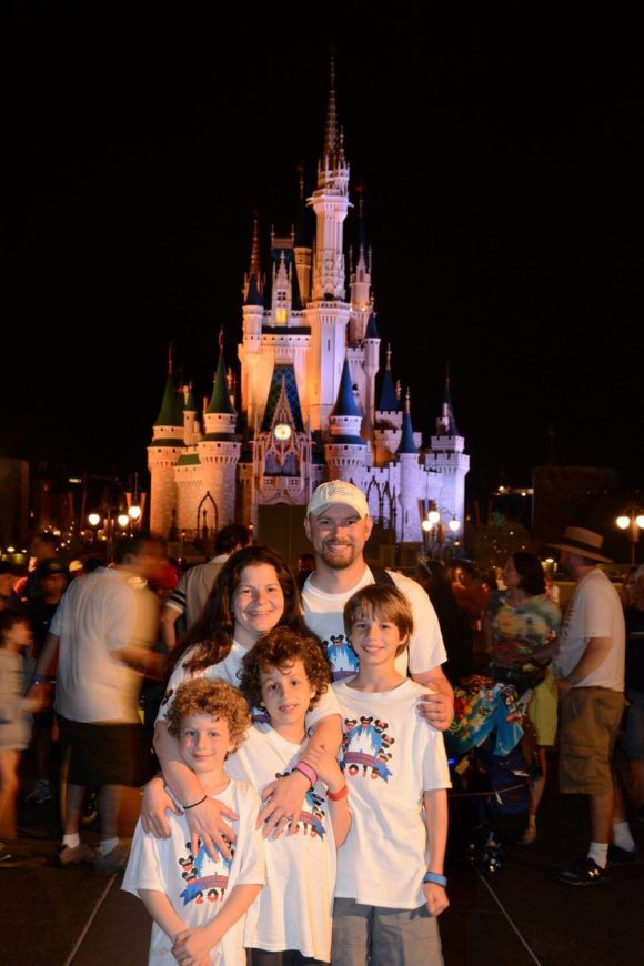 Family picture in front of the Walt Disney World castle