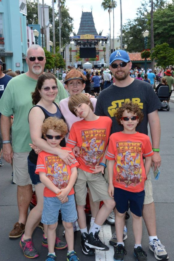 family with grandparents stand on the main strip of Hollywood Studios.
