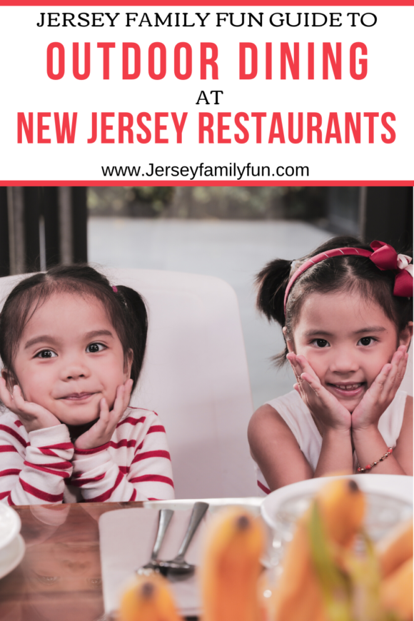 two Asian girls being silly as they wait to eat outdoors at a New Jersey restaurant
