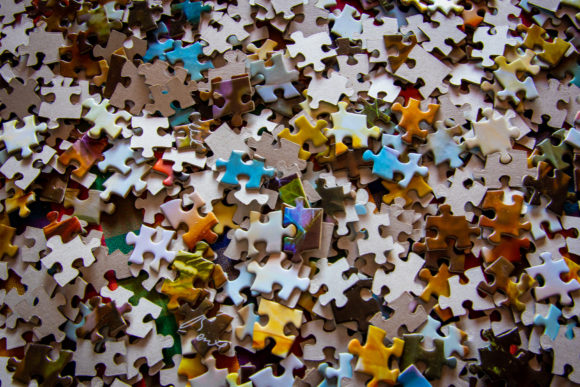 an image of assorted puzzle pieces in a pile