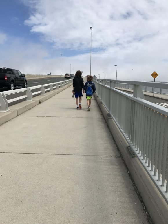 two boys walking on the Ocean City Bridge pedestrian path