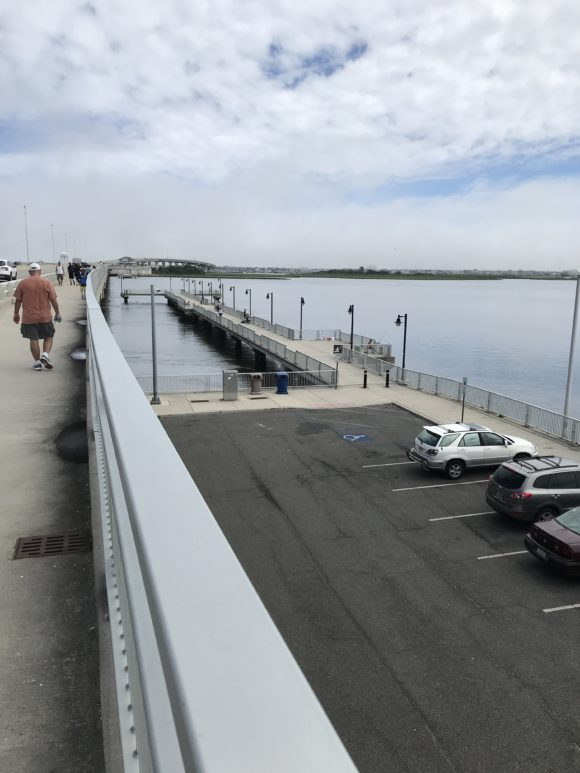 The Ocean City Bridge is shared by pedestrians, bikers, drivers, and fishers.