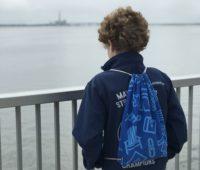 boy overlooking the bay at Ocean City Bridge pedestrian walkway observation point