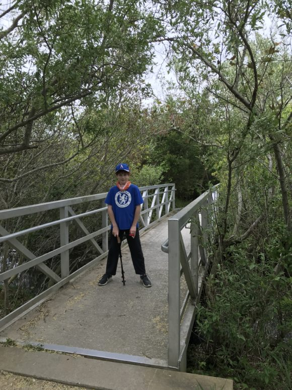 boy on bridge of a hiking trail