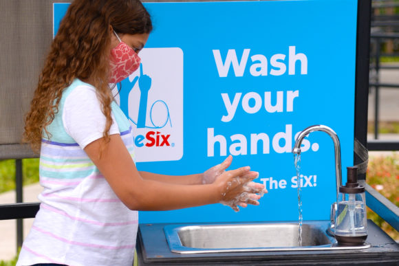 child washes hands at Six Flags Great Adventure