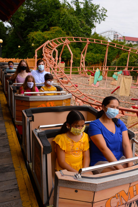 Six Flags Great Adventure reopens rides to families wearing masks.