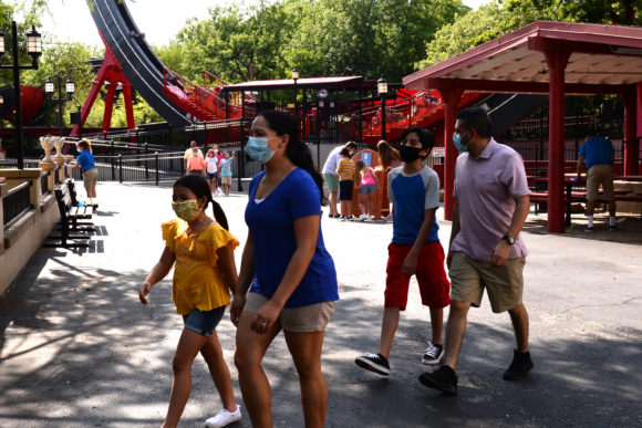 Family walks through the park when Six Flags Great Adventure reopens.
