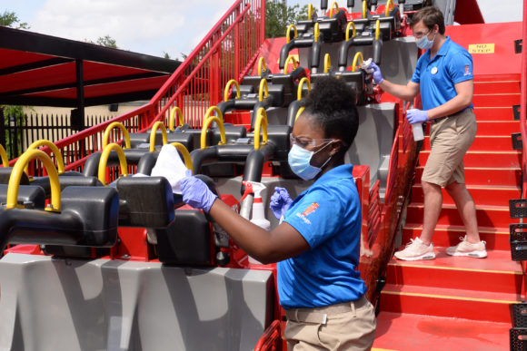 Staff members clean a ride, after operation, at Great Adventure.