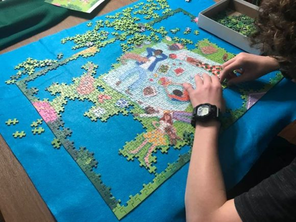 boy works on picnic puzzle from Lemonade Pursuits