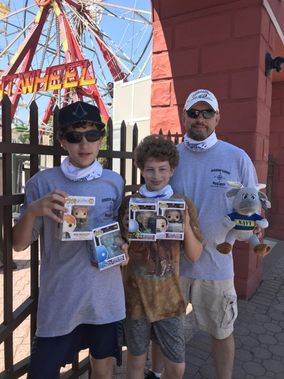 A family holds prizes they won in the Fantasy Island arcade.