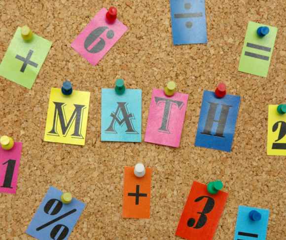 The word math on a bulletin board with other numbers and math symbols