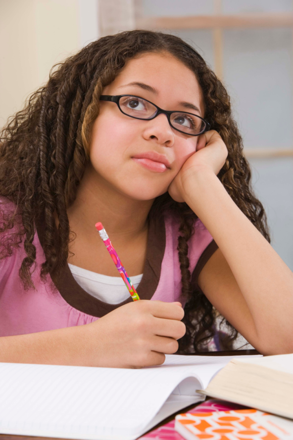 Girl thinking and writing about writing prompts for New Jersey Kids