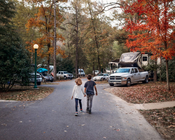 Kids walking a paved path in an RV campground in New Jersey