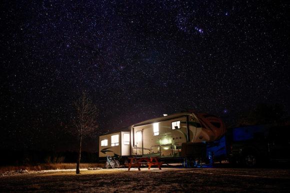 RV trailer rental parked under the stars