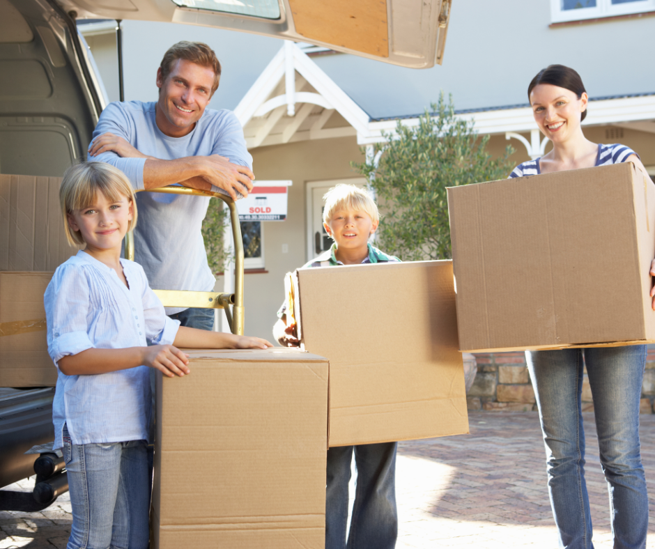 family moving into a New Jersey home carrying moving boxes