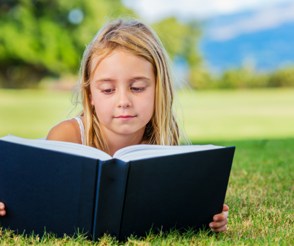 girl reading a children's chapter book about race