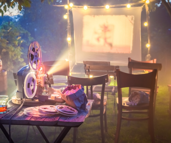 an image of backyard set up for an outdoor movie.