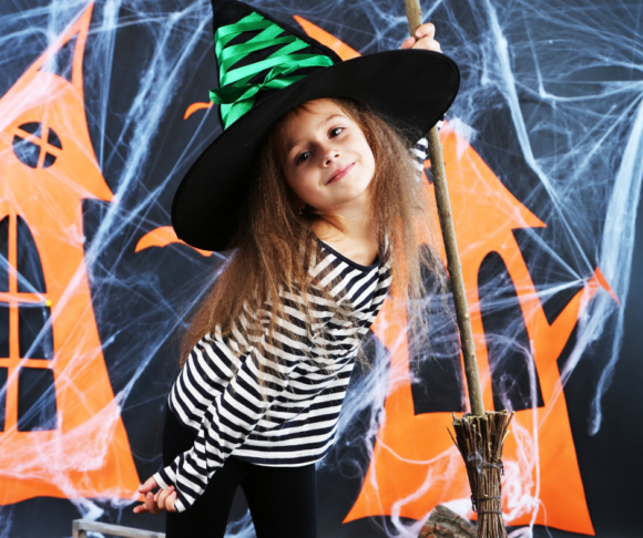 A NJ girl dressed as a witch poses before going trick or treating in New Jersey
