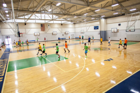 Kids play on the full size wood basketball court at the Williston Northampton School where the World Sports Camp are offered.