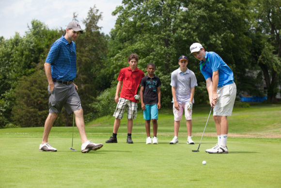 Golfers in a golf summer camp learn from World Sports Camp counselors.