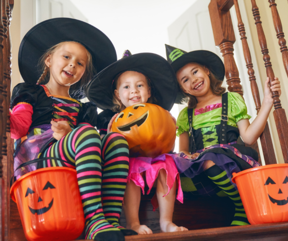 Kids sit on stairs after trick or treating in New Jersey