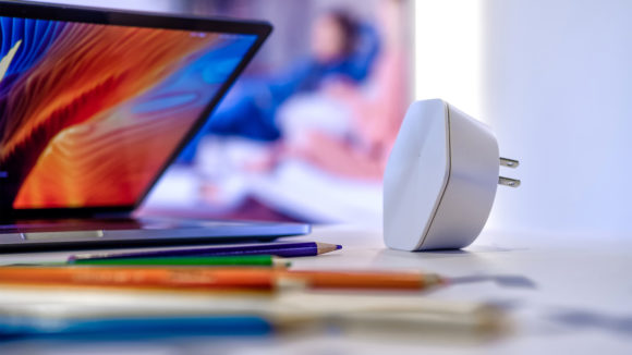 A chromebook positioned near an Xfinity internet extender pod can help make your home wifi work better.