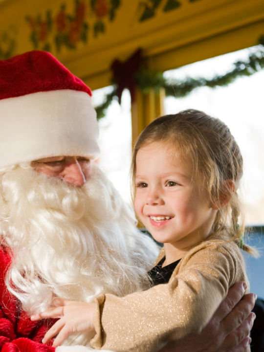 Santa with a young girl during New Jersey Christmas Train rides