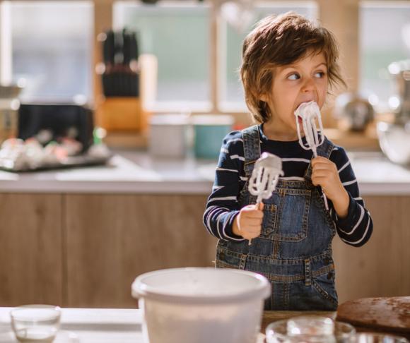 boy in kitchen making gluten free cake
